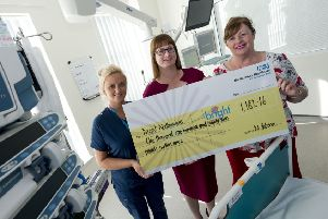 Nicola Dobson (centre) hands over the cheque to nurse Laura King and Brenda Longstaff from Northumbria Healthcare's Bright charity. Picture by Gavin Duthie Photography.