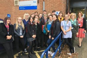 Students from St Thomas More RC Academy with staff at the clinic which is going to be made more young people friendly thanks to a partnership with Northumbria Healthcare NHS Foundation Trust and Tyne & Wear Citizens.