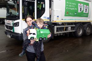 Axl and his mum Sarah with a North Tyneside Council bin wagon and his toy wagon presented to him by council staff.