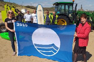 Melanie�Thomas, Tynemouth Surf Co and Elected Mayor Norma Redfearn CBE with, back,  Dave Calvert, Cullercoats Bike and Kayak, Marcus Jackson, Environmental Services Team Leader; Louis Thomas-Hudson, owner of Tynemouth Surf Co and the team from environmental services.