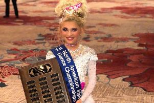 Young Irish dancer Rose McDowell, from Cramlington, with her trophy.
