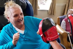 Resident Ann Sturrock gets involved in an armchair karate class at The Oaks Care Home, in Blyth.