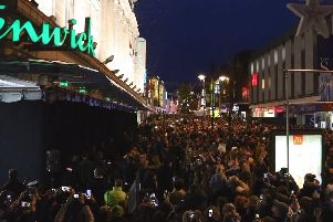 Crowds gather to watch the unveiling of the Christmas window at Fenwick's in Newcastle.