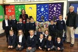 Children from Eastlea with their donations for Cramlington Food Bank