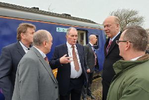 Chris Grayling, second from right, with the three Bedlington councillors, left, and council leader Peter Jackson, right, during the visit.