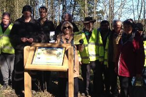 Coun Marjorie Chambers with staff from Groundwork North East & Cumbria and volunteers from Ashington Community Woods install an interpretation panel.