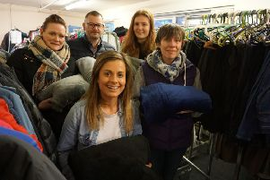 The All-in-One Company brand manager Rachel Lister (front), Making Winter Warmer volunteers and donated blankets.