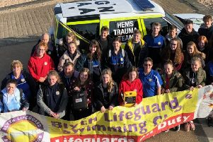 Blyth Lifeguards & Swimming Club members with their defibrillator.