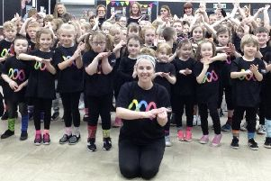 Children at Loud Arts CIC take part in a viral Sing and Sign video for International Downs Syndrome day.