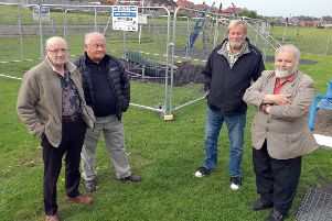 East Bedlington Parish Councillors John Batey,  Alex Wallace,  Allan Stewart, and Paul Hedley in the vandalised play area. Picture by Jane Coltman