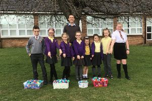 Pupils at Horton Grange Primary School with some of the plastic lids they collected.