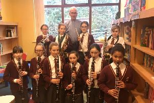 Whittingham's young musicians and  Reverend Ian Chadwick