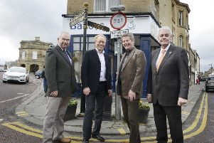 Bill Grimsey with councillors George Mavin and Gordon Castle and town council projects officer Tim Kirton during his tour of Alnwick.  Picture by Jane Coltman