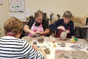 Potters at work at the First Time for Everything class.