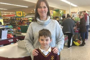 Louise Hodgson, chairman of the PTA, with son Archie at the bag pack in Morrisons.