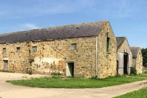 A picture of the two barns to be converted and the other to be demolished, which was submitted with the application.
