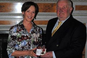 David O'Connor receives his BEM from the Duchess of Northumberland.