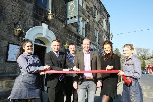 Coun Steven Bridgett, second left, cuts the ribbon with, left to right, Jenny Hale, Punch development manager Simon Lynch, publicans Craig and Nicola Fortune and Anna Coe.