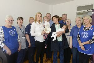 Ada Rose Telfer with mum Olivia, dad Simon, big sister Eliza, the Duchess of Northumberland, staff from Hillcrest maternity unit and members of the League of Friends. Picture by Jane Coltman