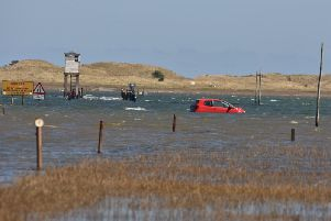 The car on the causeway. Picture by Dave Siggens