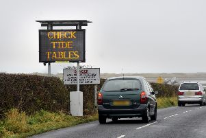 One of the signs on Holy Island encouraging people to check the tide times for the causeway.