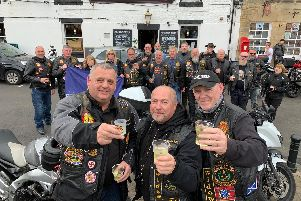 Tom Stewart, Peter Younger and Mike Ewart with other members toasting the anniversary