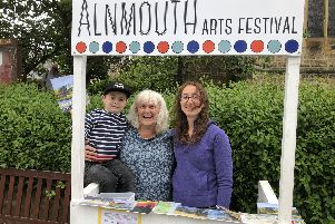 Selling programmes at the Alnmouth Arts Festival are Hilary Burns, her daughter Caitlin, and grandson Henry, nearly five.