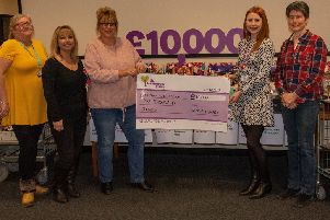 Library workers boost hospice funds with hamper raffle