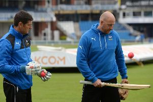 NOT CONVINCED: Yorkshire director of cricket 'Martyn Moxon and first-team coach Andrew Gale study the pink balls used this week at Headingley against Surrey.Picture: Bruce Rollinson