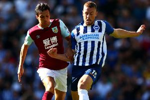 Burnley's Jack Cork and Brighton's Adam Webster at the Amex Stadium