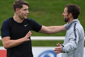 Burnley defender James Tarkowski and England boss Gareth Southgate in conversation during a training camp at St George's Park