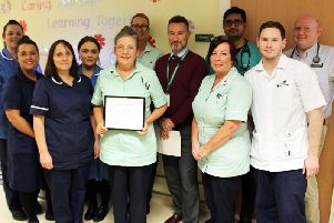 Anne Duxbury is presented with her 'Employee of the Month' award