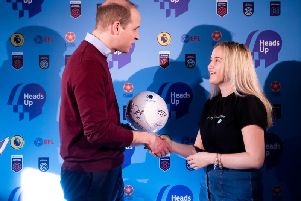 HRH the Duke of Cambridge presents Beth Hope with her signed football