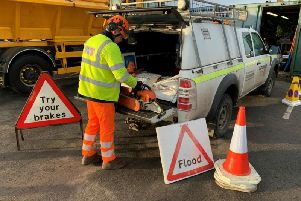 A highways officer loading a van with equipment to prepare for the storm