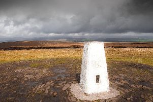 The much-visited trig point at the top of the hill.