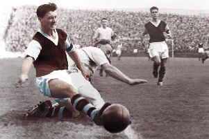 Jimmy McIlroy in action for Burnley