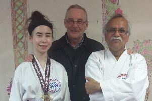 Anice Kelly with her proud father Stephen Kelly and karate instructor Khurshid Ismail. (s)