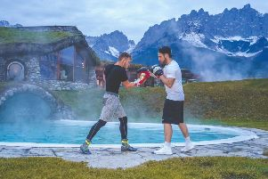 Josh Holmes (left) trains at the at the famous Stanglwirt hotel in Austria with personal trainer Bj�rn Schulz