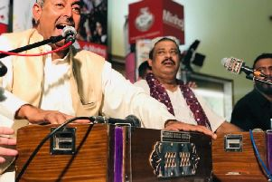 Fareed Ayaz and Abu Muhammad, who are popular for performing Qawwali Sufi music. (s)
