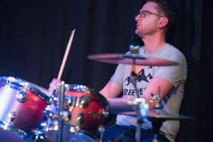 Andy Henderson, the drummer for Northern Social Band. (s)