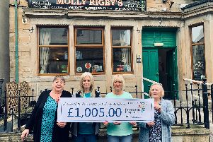 Pictured with the cheque from the fund raising night are (from left to right) Margaret Brick, a friend of the Wilkinsons, a representatives of the hospice,  Tracey and Beverley.