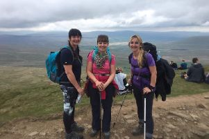 Teachers delighted having completed the Three Peaks Challenge