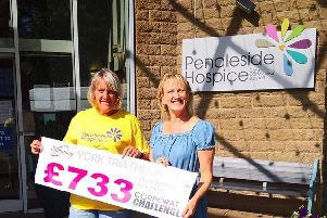Barrowford Slimming World leader Janet Barnes hands a charity cheque to fund Christine Cope, who works for Pendleside Hospice.