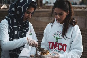 TheHajjah Naziha Charitable Organisation has been giving out hot food, snack packs, hygiene kits and offeringfree haircuts at the Thompson Centre car park everyWednesday evening. Photo credit: Natasha Hibbert.