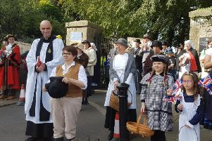 The Rev. Andy Froud with the procession at the Clitheroe Castle Gates