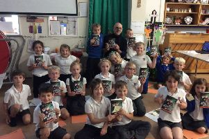 Author Nick East is pictured with pupils at Warter CE Primary School.