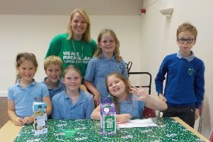 Bishop Wilton Primary School pupils are pictured with Macmillan representative Lucy during the successful coffee afternoon.