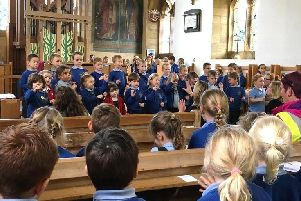 Barmby Moor CE Primary School pupils sing at the Harvest Festival in St Catherine's Church.
