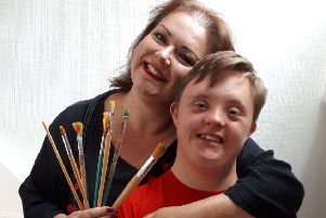 Portrait artist Sue Clayton, who is appealing for help, is pictured with her son James.