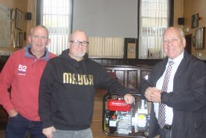 Pocklington Town councillor Martin Cooper, Cllr Hodgson and Cllr Stathers with one of the new water pumps.